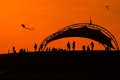 sunset (engin_photos) Tags: sunset evening sea landscape nature kite people red fly park sekapark