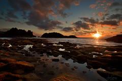 A sunset between rocks (gjaviergutierrezb) Tags: rocks sea sunset seascape clouds darkclouds golden hour tacoronte beach sky tenerife tenerifenorth canarias islascanarias canaryislands