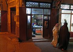Street at Night - Fez, Morocco (TravelsWithDan) Tags: night street women covered walking candid men chess city urban medina fez morocco africa canong3x indoorsandoutdoors darknessandlight menandwomen