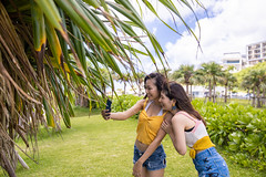 Young women taking selfie picture at resort (Apricot Cafe) Tags: people green nature grass japan outdoors asia day friendship longhair happiness copyspace naha leaning carefree lifestyles casualclothing leisureactivity okinawaprefecture photograhing onlyyoungwomen japaneseethnicity millennialgeneration asianandindianethnicities travel summer sky tourism smiling photography togetherness women tourist smartphone straighthair youngadult vacations twopeople selfie toothysmile realpeople traveldestinations threequarterlength imgr32358