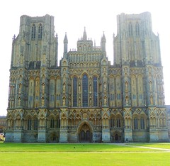 Imposing (Kevin Pendragon) Tags: wells cathedral somerset westcountry outdoors outside sun sunshine heat hot weather clouds stone big building tall structure green grass old windows statues towers shadows light dark worship religion religions historic history colour ancient sky photo photograph picture image photography