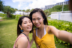 Young female friends taking selfie picture at beach resort in summer (Apricot Cafe) Tags: nature grass japan outdoors asia day friendship happiness naha carefree lifestyles casualclothing lookingatcamera leisureactivity okinawaprefecture onlyyoungwomen japaneseethnicity millennialgeneration asianandindianethnicities travel summer sky people tourism smiling photography togetherness women tourist youngadult vacations twopeople photographing selfie sleeveless toothysmile realpeople traveldestinations waistup imgr32371