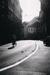 weather's high (Marco Buccelli) Tags: inthesummertimewhentheweatherishighyoucanstretchrightupandtouchthesky weathershigh harshfrontallight bicycle cycling peopleinthestreet hotinthecity smoothcurve sunshine summerevening buildingsinmono contrejour streetphotography 35mm