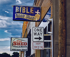 ONE WAY (Pete Zarria) Tags: nebraska bible god religion books gifts neon sign red blue yellow cloth priest minister pastor sunday school