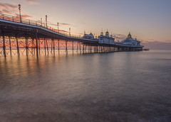 staring at the sky as time goes by (Wizard CG) Tags: uk eastbourne pier england water long exposure sunrise sea beach east sussex united kingdom dawn victorian ocean sand stones reflection reflections clouds sun