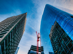 Non-stop (Мaistora) Tags: building buildings architecture modern contemporary highrise tower towers skyscraper construction crane development offices residential business commercial city cityoflondon squaremile aldgate towerhamlets towerhill sky skyline clouds blue red color colour vivid vibrant sunny sunshine summer street walking passingby up upward skyward crossroads leica dlux typ109 lightroom skylum luminar london england britain uk brexit economy investment capital europe world explore explored02sep19