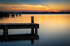 Sunset on the lake (FotoFloridian) Tags: dusk florida lake outdoors reflection scenics sony summer tranquilscene woodmaterial a6400 alpha landscape nature pier sky sunset water
