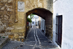 Through the Arch (Jocelyn777) Tags: streets road arch gate cobblestones cobblestonestreets stone stonebuildings buildings archtecture villages towns whitevillages pueblosblancos vejerdelafrontera andalucia spain travel