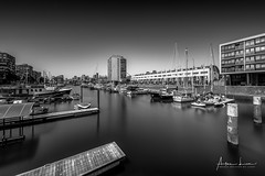 Marina Rotterdam I (Alec Lux) Tags: bw bnw rotterdam architecture art black blackandwhite boats building buildings canal city cityscape exterior facade fine fineart haida haidafilters harbour jetty longexposure netherlands outdoor outside pier pontoon skyline urban water white
