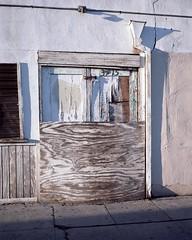 Sunbaked Ktown garage (ADMurr) Tags: la ktown garage worn plywood paint sunbaked mamiya 7 80mm kodak ektar 6x7 mf dac937