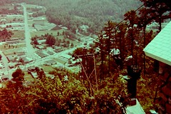 Chair Lift (fillzees) Tags: overlook tree chairlift road street retro person tourist roof number building town sign