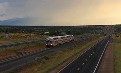 Running the rain (GLC 392) Tags: rail runner commuter rain monsoon highway passenger train railroad railway santa fe new mexico nm nmrx mpi mp36ph3c motive power industries department transportation sunset sun set clouds sky i25 103