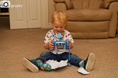 Camera Present (Mike House Photography) Tags: child birthday toddler present camera baby happy joyous love family amazed portrait photo photography photographer junior