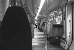 Looking down a Thameslink Carriage (andy broomfield) Tags: film filmphotography analogue 35mm 35mmphotography blackandwhite bw prakticamtl3 ilfordhp5 ilfordhp5plus400 thameslink train insidetrain filmisnotdead