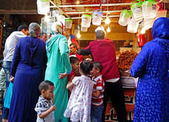 Adults barter, Kids play - The Souk, Fez, Morocco (TravelsWithDan) Tags: children adults families shop store city urban souk fez morocco africa bartering playing candid streetphotography canong9x