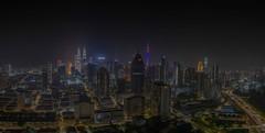 Kuala Lumpur at Night (Daveoffshore) Tags: kuala lumpur malaysia city night light building panorama panoramic multiple exposure photomerge road petronas twin tower kl sky nikon david ferguson daveoffshore