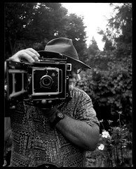 Self-Portrait with Speed Graphic 190816 (jimhairphoto) Tags: peopleofthe21stcentury self portrait documentary photography stjohns portland america nw northwest leftcoast oregon streetlife streetstories théâtrederue remainsoftheday naturalworld 4x5 speedgraphic camera mfg1953 90mm optarlens film ilford hp5 blackandwhite blancetnoir schwarzweiss blancoynegro blancinegre siyahrebeyaz jimhairphoto