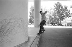 7.27.19_MCW_HP5-26 (arterial spray) Tags: 35mm 400 bw bayarea black boxspeed building ca california curb dalliswillard dalliswillardphotography embarcadero f100 film hp5 ilford nikon sanfrancisco session sf siliconvalley skate skateboarding skater skyline slappy transamerica white