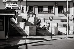 enjoying the sun (Gerard Koopen) Tags: espana spain malaga city urban enjoying sun people architecture street streetphotography dailylife streetlife blackandwhite blackandwhiteonly noir light fujifilm fuji xpro2 56mm 2019 gerardkoopen gerardkoopenphotography
