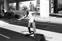 7.27.19_MCW_HP5-10 (arterial spray) Tags: 35mm 400 bw bayarea black boxspeed building ca california curb dalliswillard dalliswillardphotography embarcadero f100 film hp5 ilford nikon sanfrancisco session sf siliconvalley skate skateboarding skater skyline slappy transamerica white