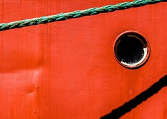Porthole (Karen_Chappell) Tags: window round circle red green shadow boat ship paint painted bright colour color colourful stjohns harbour marine rope line canada nfld newfoundland eastcoast avalonpeninsula atlanticcanada canonef24105mmf4lisusm metal steel abstract
