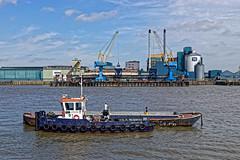 Sugar (Croydon Clicker) Tags: factory refinery sugar cranes boat barge river water sky cloud thames london woolwich silvertown nikon sigma