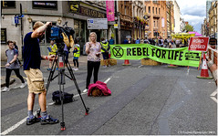 Reporting On The Day's Events (Explored 03-09-2019) (Fermat 48) Tags: extinctionrebellion deansgate manchester police demonstration roadclosed trafficcones planetbeforeprofit yacht thelostdene rebelforlife