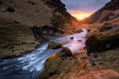 Valley of light (Pete Rowbottom, Wigan, UK) Tags: sunlight valley river stream cliffs sunset photographer flow water iceland warmth winter landscape peterowbottom grass mountains intothesun loneperson nisifilters fotopro creek light beauty nature longexposure slowshutterspeed sky landscapephotography scandinavian europe travel
