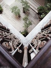 Over The Balcony (peterphotographic) Tags: p7250561cb2magkitedwm olympus overthebalcony cheongfatttzemansion bluemansion em5mk2 microfourthirds mft ©peterhall penang malaysia seasia asia camerabag2 corner balcony lookdown courtyard tree fengshui rust house home building georgetown unesco