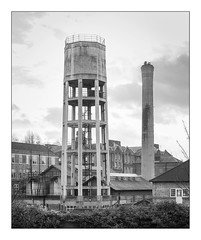 The Built Environment, North London, England. (Joseph O'Malley64) Tags: thebuiltenvironment newtopography newtopographics manmadeenvironment manmadestructures buildings structures watertower chimney industrial industrialbuilding industrialbuildings steelreinforcedconcretestructures architecture industrialarchitecture architecturalphotography documentaryphotography britishdocumentaryphotography urban urbanlandscape steelrailings brickwork bricksmortar cement pointing roofingslates roofingtiles windows walls compound industrialcompound skylights fujix fujix100t accuracyprecision