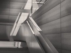 One never reaches home, but wherever friendly paths intersect the whole world looks like home for a time (wiseacre photo) Tags: applevisitorcenter apple windows shadows light cement stairs stariwell bw blackandwhite iphone