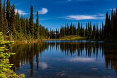 Revelstoke Mountain Nationalpark (laird.lothar) Tags: outdoor reflections lake trees mountain blue sky water clouds rockymountains revelstoke canada beautiful sunny nature