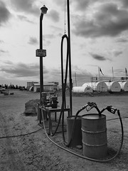 Eagles Plains Diesel pumps (oneofmanybills) Tags: diesel eagleplains dempsterhighway dempster yukon bw blackandwhite fuel canada olympus micro43