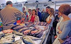 Solemly watching fish getting cut - Public Market, Lisbon, Portugal (TravelsWithDan) Tags: publicmarket city urban people fish fishmonger europe spain cadiz candid guttingfish cleaningfish watching solem