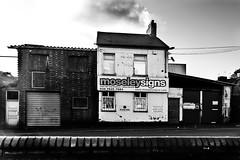 Street (lightersideofdark) Tags: blackwhite street streetphotography dark outside outdoors cloud sky brickwall brick wall architecture urban