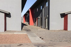 Apartments off Grand Avenue (GC_Dean) Tags: phoenix arizona apartmentbuilding morninglight sidewalk gravel brutalism street emptiness mundane city cityscape urban urbanlandscape sociallandscape space colors color colours structure building shadows
