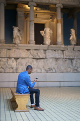 Room 17 (Julian Heritage) Tags: nereidmonument britishmuseum tombfromxanthos nereids seanymphs temple monument exhibit gallery sculpture museum people person candid city london iphone earphones listening culture art streetphotography