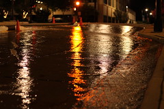 street water reflections (jbouikidis) Tags: night lights traffic street water hydrant reflections yellow black red brown shine stoplight trafficlight movingwater buildings stores johnson racine wisconsin mainstreet