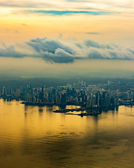 Golden view of a green country (FVillalpando) Tags: aereas panama aerial landscape cities sunset light clouds sky water ocean goldcolor ngysa