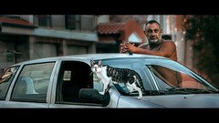 """The smallest feline is a masterpiece."" —Leonardo da Vinci- (Lorrainemorris) Tags: portrait zeissbatis85 85mm zeiss sony7rm2 streetphotography car man tones moviescene art candid streetphoto cat"