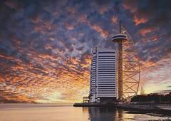 a lisbon sunset (AChaby) Tags: acyro portugal lisboa lisbon parquedasnações buildings sunset sky water rio river tejo tagus