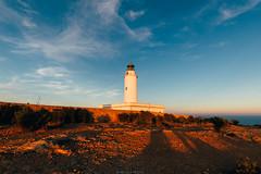 Warm sun (Nicola Pezzoli) Tags: formentera isola island spain sea mediterraneo mare holiday vacanze baleari baleares nature natura far faro lighthouse sunset tramonto mola cliff golden hour