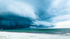 Racing To Safety (Ann Kunz) Tags: sky storm clouds florida fortmyersbeach travel seascape weather nature beach ocean boat