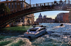 Under the Accademia bridge (Jan Kranendonk) Tags: santamariadellasalute grand canal grande venice italy itailan european water river houses buildings europe mansons palazzo historical culture church religion boats santamariadellasalutesalute speedboat speed bridge wooden accademia sunlight backlight