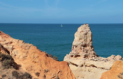 The rock formations (Behappyaveiro) Tags: algarve carvoeirobeach summer summertime sea boat oceanoatlântico ocean atlanticocean seascape colours barco blue water sun sail horizon outside rock sand broadwalk portugal europe europa