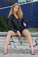 Chiara 11 (The Booted Cat) Tags: sexy cute teen model girl long blonde hair legs heels highheels feet foot barefoot barefeet leather jacket denim jeans hotpants sandals
