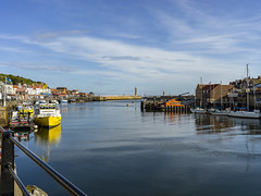 Sunny day in Whitby. (slack water) (johnhjic) Tags: johnhjic north yorkshire x1d xcd slack water whitby boats harbor sky rails reflection lighthouse masts town boys