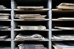 Where Earl Keeps His Old Newspapers (Studio d'Xavier) Tags: werehere newspapers grid