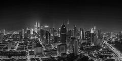 Kuala Lumpur at Night - Monochrome (Daveoffshore) Tags: kuala lumpur malaysia night monochrome city panorama petronas twin tower kl skyscraper building architecture road david ferguson daveoffshore