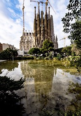 Neither Is Finished Yet (Douguerreotype) Tags: barcelona water catalunya buildings spain sagradafamilia city gaudi cathedral urban architecture reflection church